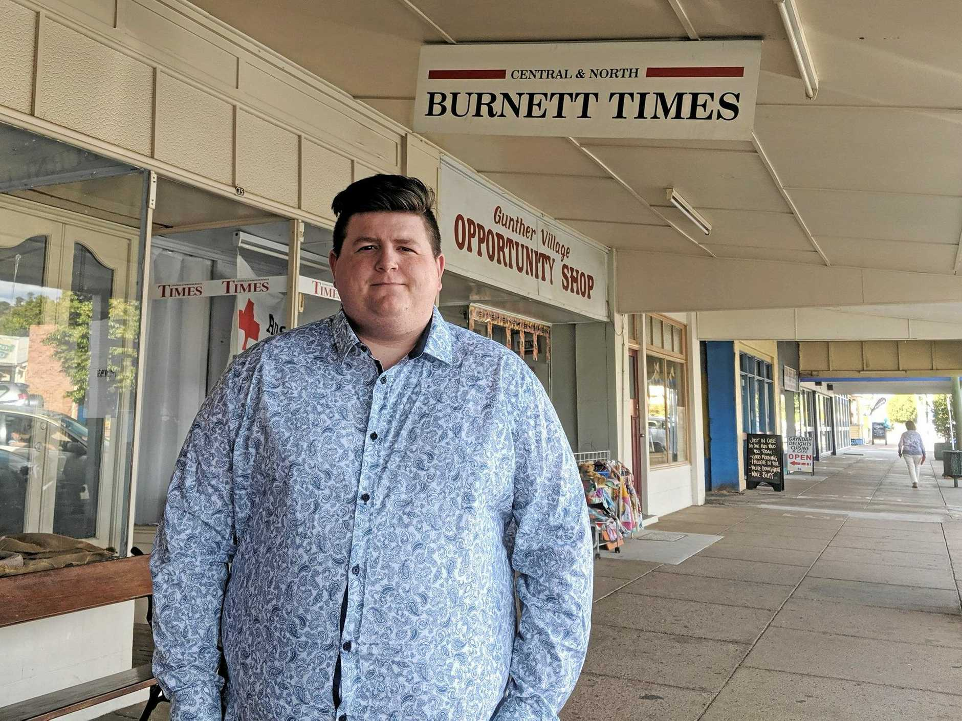 LOVING IT: Central and North Burnett Times journalist Jake Finnigan  outside the Gayndah office.