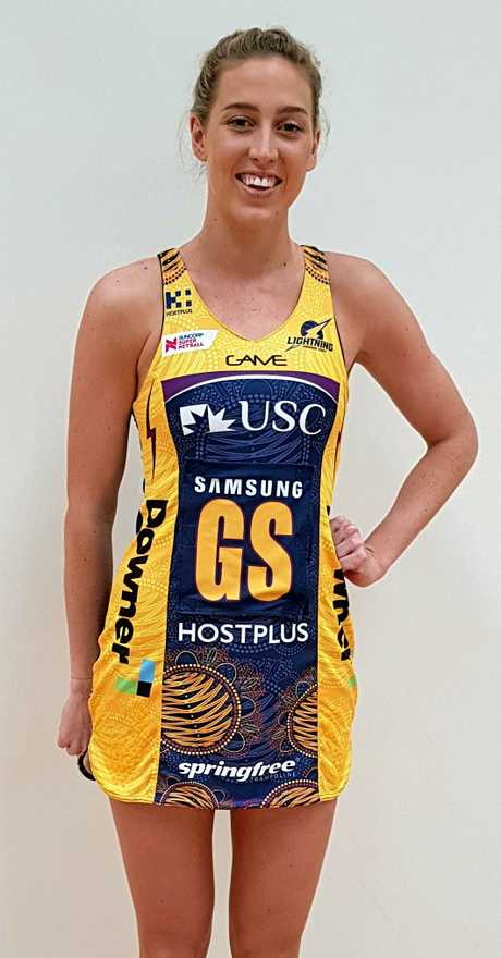 EXCITEDL: Cara Koenen with the special dress for the Suncorp Super Netball Indigenous Round.