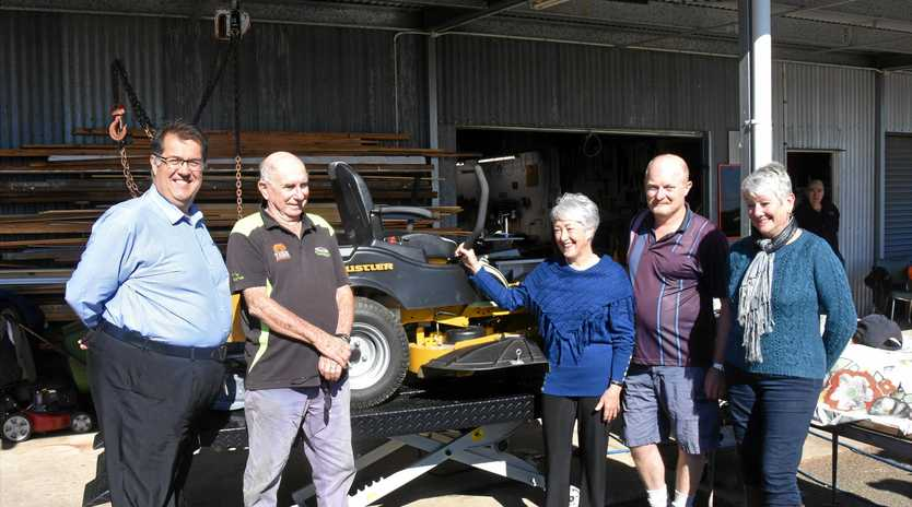 PRESENTATION: Cr Neil Meiklejohn, chief mechanic Bob Webster, Mayor Tracy Dobie, Heath Hunt and Cr Yve Stocks with the Men's Shed's new lawnmower and power lift.