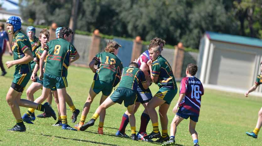 Charlie White takes the ball forward for Goondiwindi High against Assumption in Broncos Cup.