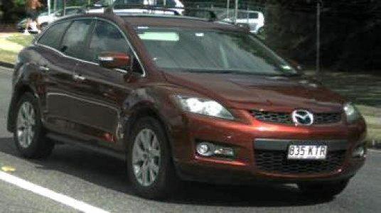 Red Mazda CX-7 station wagon, rego 835KTR.