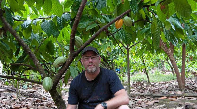 WINNING FORMULA: Metiisto Artisan Chocolate owner Trevor Smith inspects a cocoa farm in the Solomon Islands.