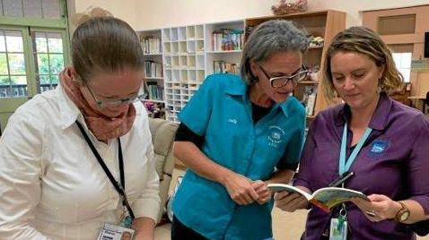 Little Haven Nurses (Left to right) Sharon Woods, Leanne Shedden and Amy Cadd looking through the latest donation of books, received today, which will be sorted and available for sale this weekend.