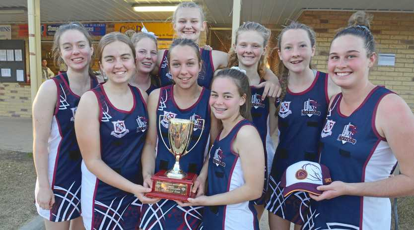 The winning Stanthorpe State High School netball team with the Broncos Cup.