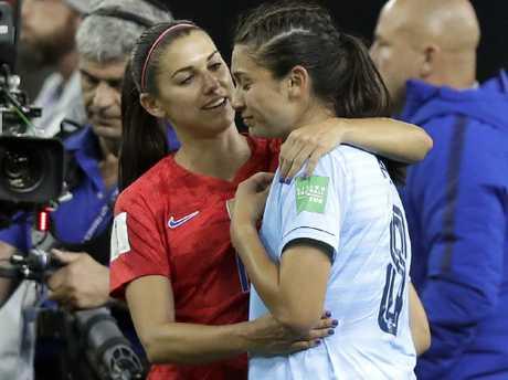 Alex Morgan hugs teary Thailand star Mirand Nild.