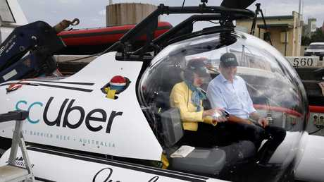 Tourism Tropical North Queensland chairwoman Wendy Morris and Qld Minister for Fire and Emergency Service Craig Crawford on board the Uber scUber in Cairns. Picture: Anna Rogers