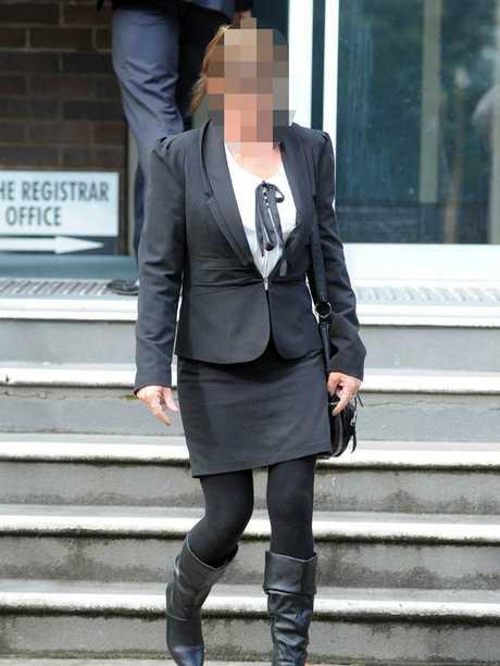 A Colt family member leaves court.
