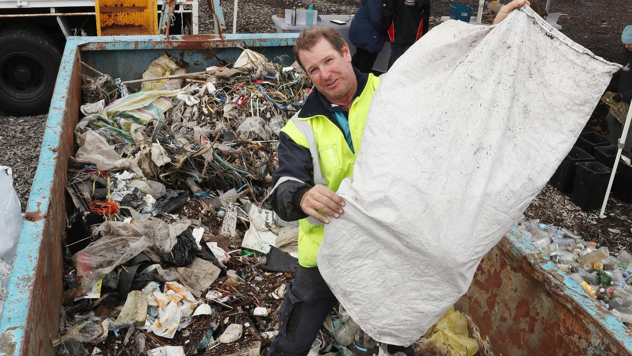 Ian Thomson from Ocean Crusaders with some of the rubbish collected during a clean-up of Moonee Creek. Picture: David Crosling