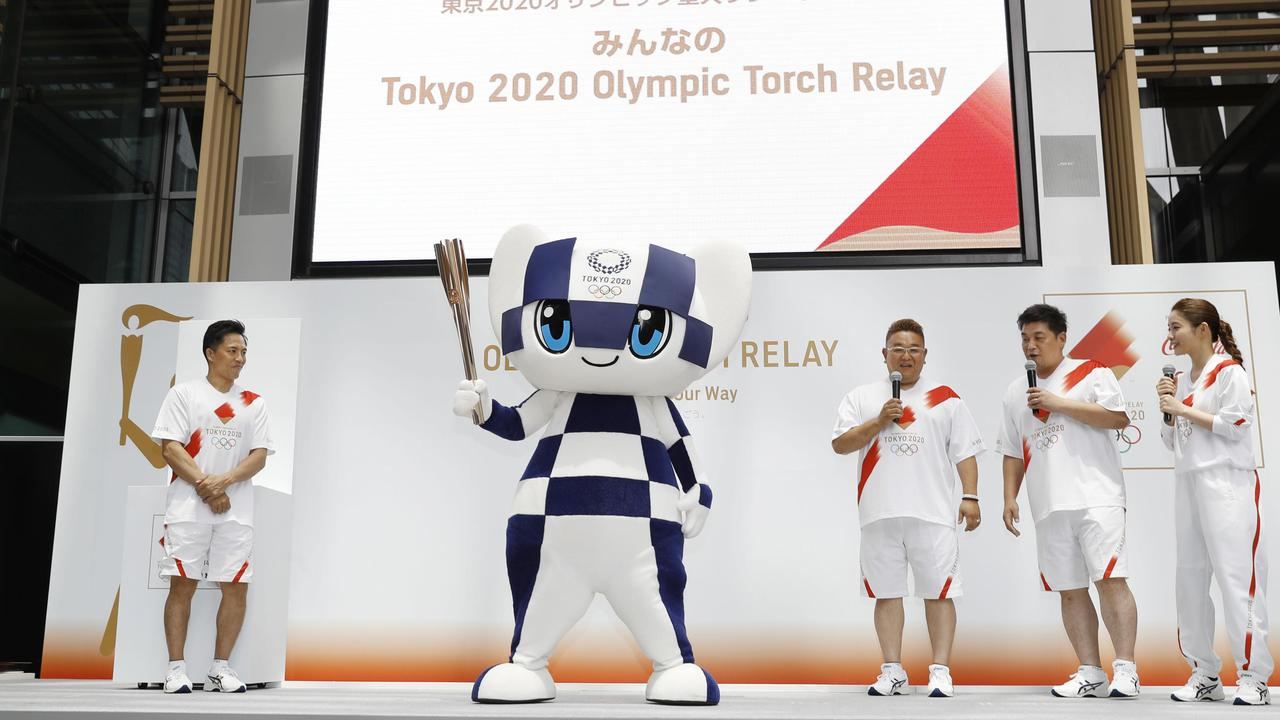 Miraitowa, the official mascot of the 2020 Summer Olympics, holds a torch during an event to unveil the Olympics torch relay route in Tokyo. Picture: Shinji Kita/Kyodo News via AP