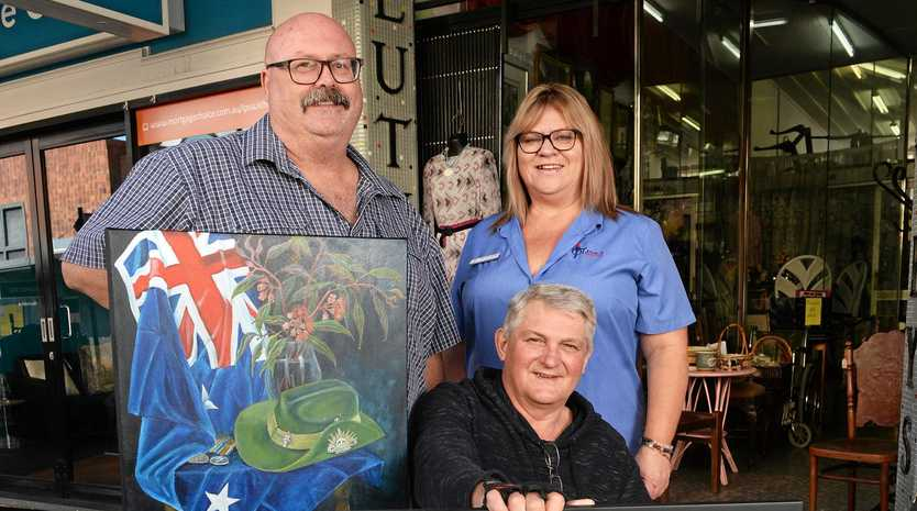 FINE ART: Artists Glen Smith and Larry Stumer with Legacy Club of Ipswich vice-president Donna Cavanagh.