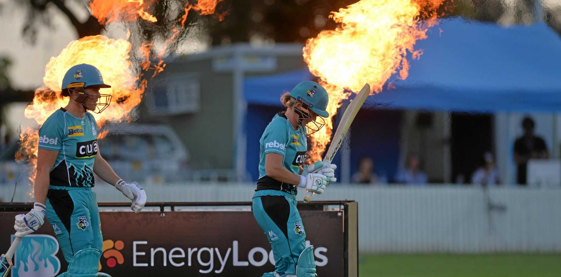 FLAME ON: Grace Harris and Beth Mooney walking out to bat first for Brisbane Heat in last year's rounds against Adelaide Strikers at Great Barrier Reef Arena.