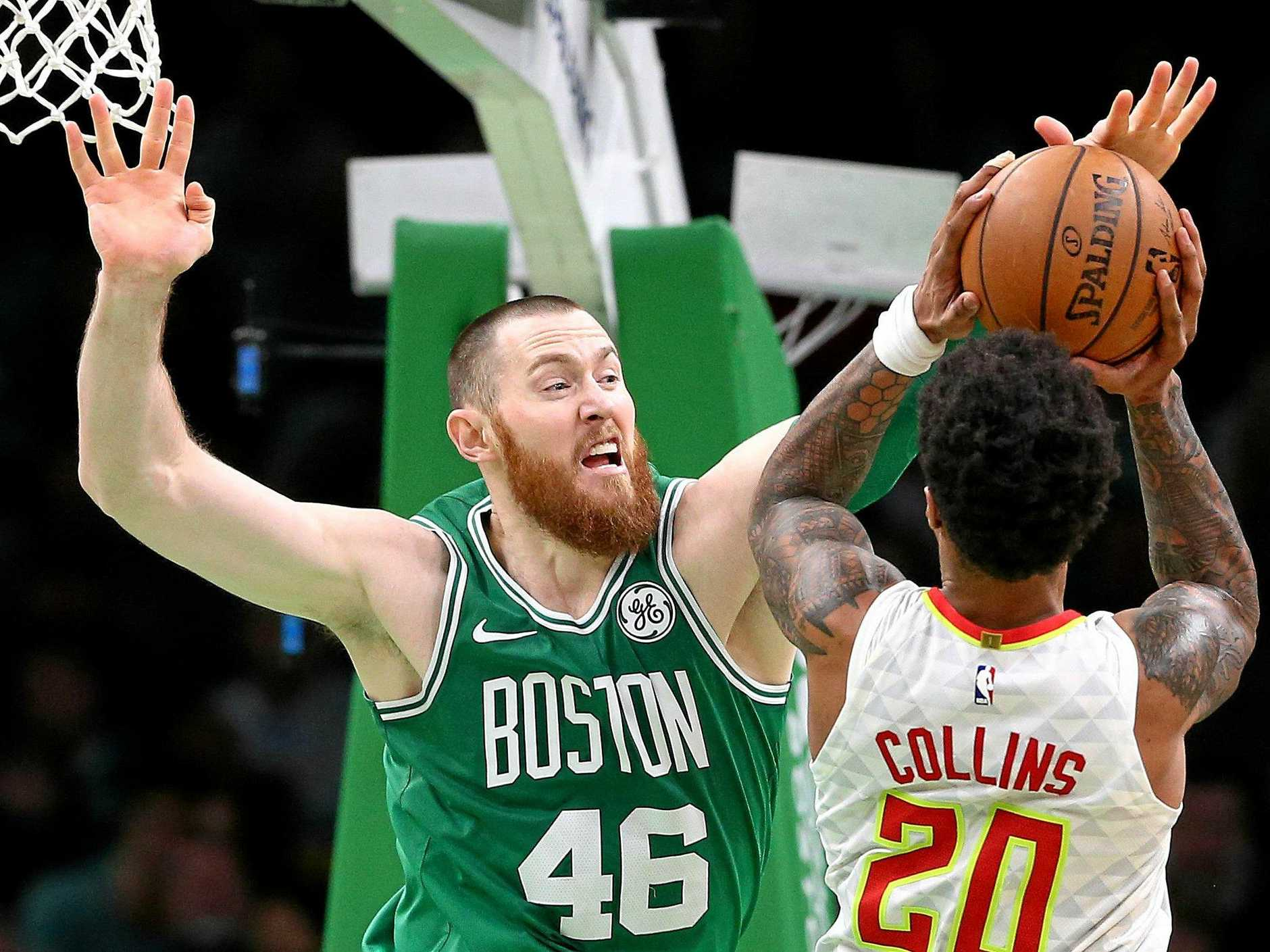 The Celtic's Aron Baynes blocks a shot from John Collins of the Atlanta Hawks on March 16 in Boston, Massachusetts. Picture: Maddie Meyer/Getty Images