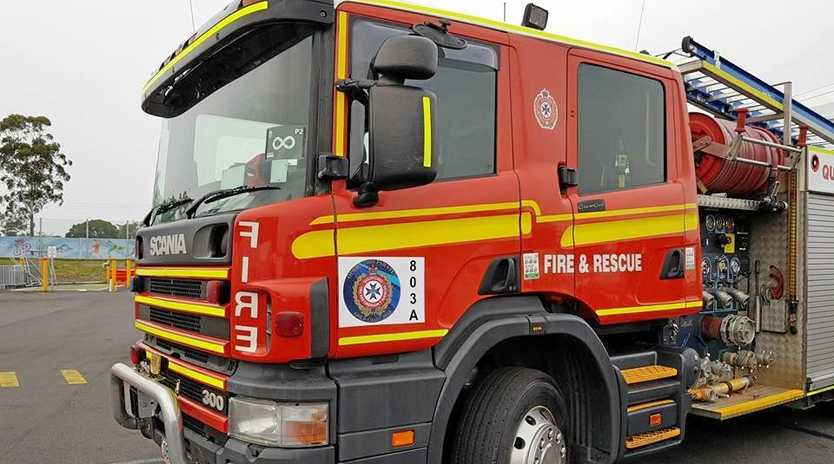 Queensland Fire and Emergency are at the scene of a tree fire near a children's playground.