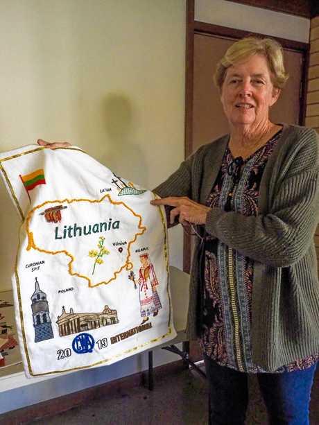 Mundubbera QCWA branch president Margaret Kelly with her tea towel.