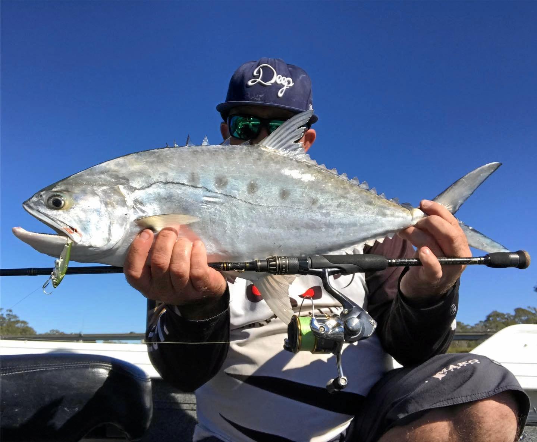 Jordan Stoddart with the queenfish he caught in the Burnett River.