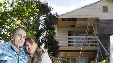 A tarpaulin has protected the roof of Ken and Elizabeth Harris' house at Shailer Park since a minio-cyclone ripped it off in December. PHOTO: AAP`/Renae Droop)