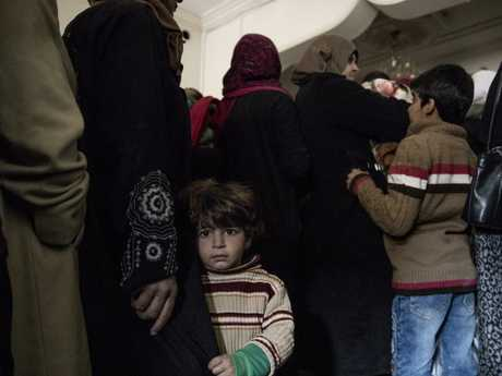 The line at a health clinic run by the Syria Arab Red Crescent in Deir ez Zor. Picture: Ella Pellegrini