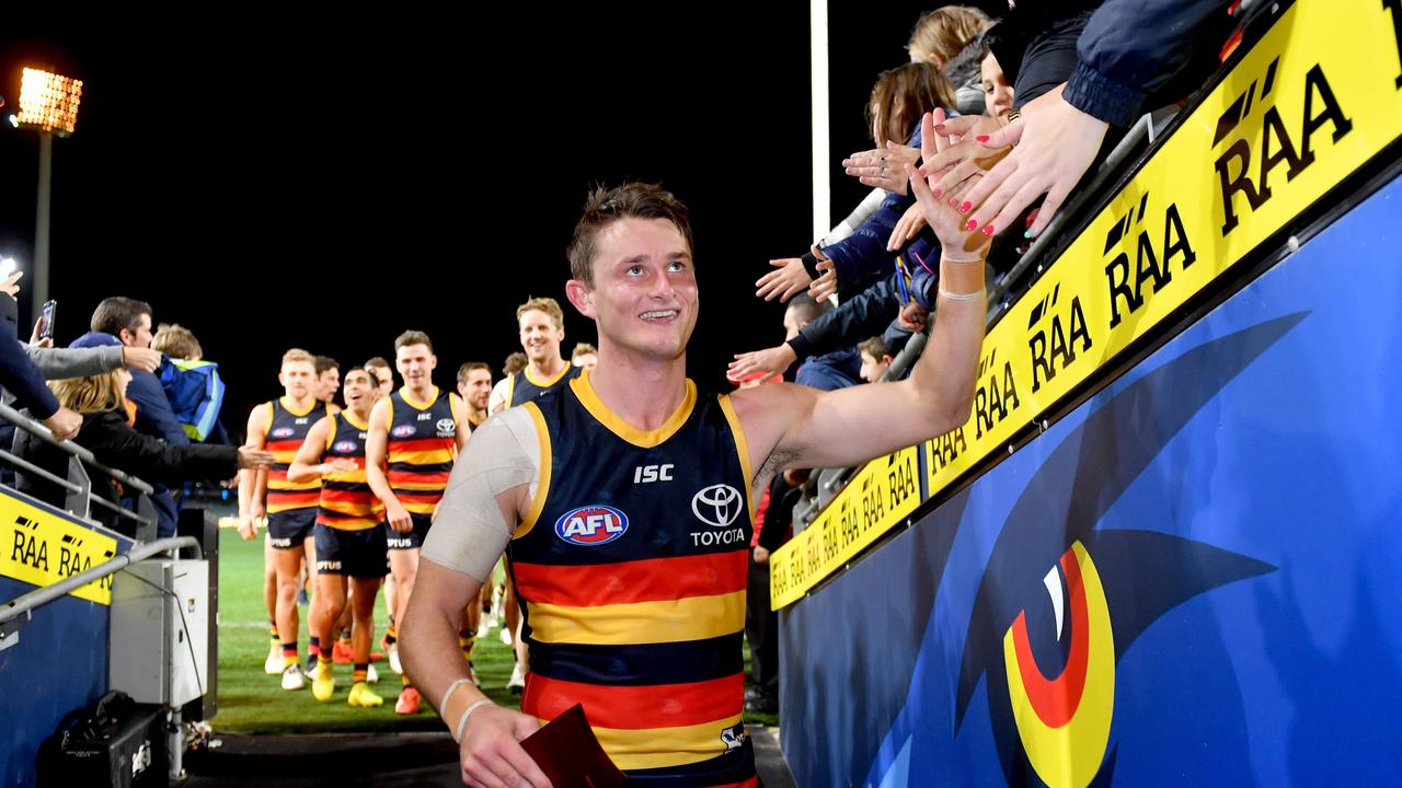 Matt Crouch soaks up the applause of the Crows fans after his milestone match. Picture: AAP Image/Sam Wundke.