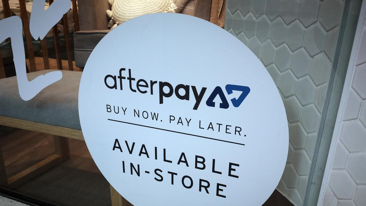 An Afterpay sign is seen in a store window in a shopping centre.