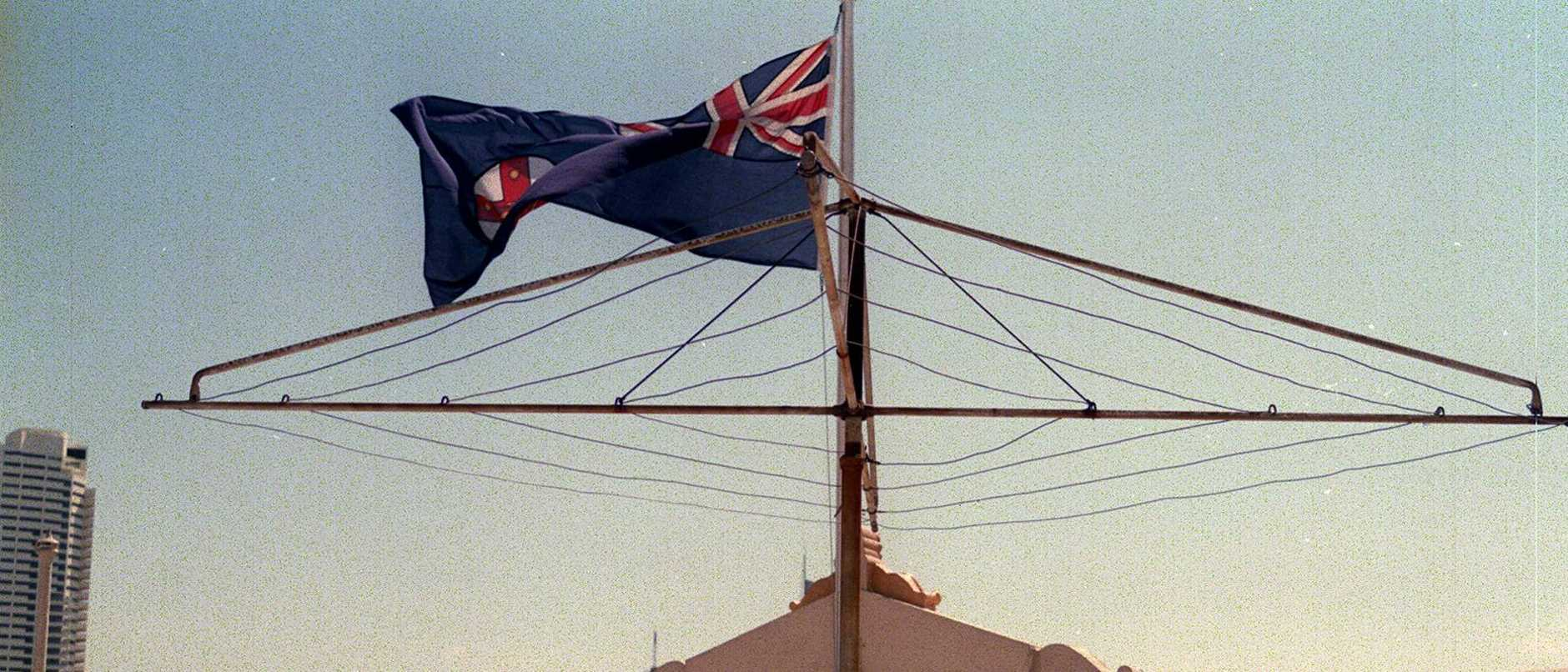 Generic photo of Hills Hoist clothes line. Australian flag on a washing line. Clothes line.