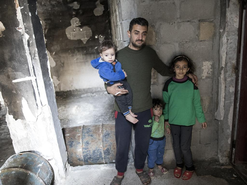 Veterinarian Mohammed Nabeel El-Al Andaleeb Al-Matik, lives with his wife and four children in a flat with no water, electricity, doors, windows or furniture. Picture: Ella Pellegrini