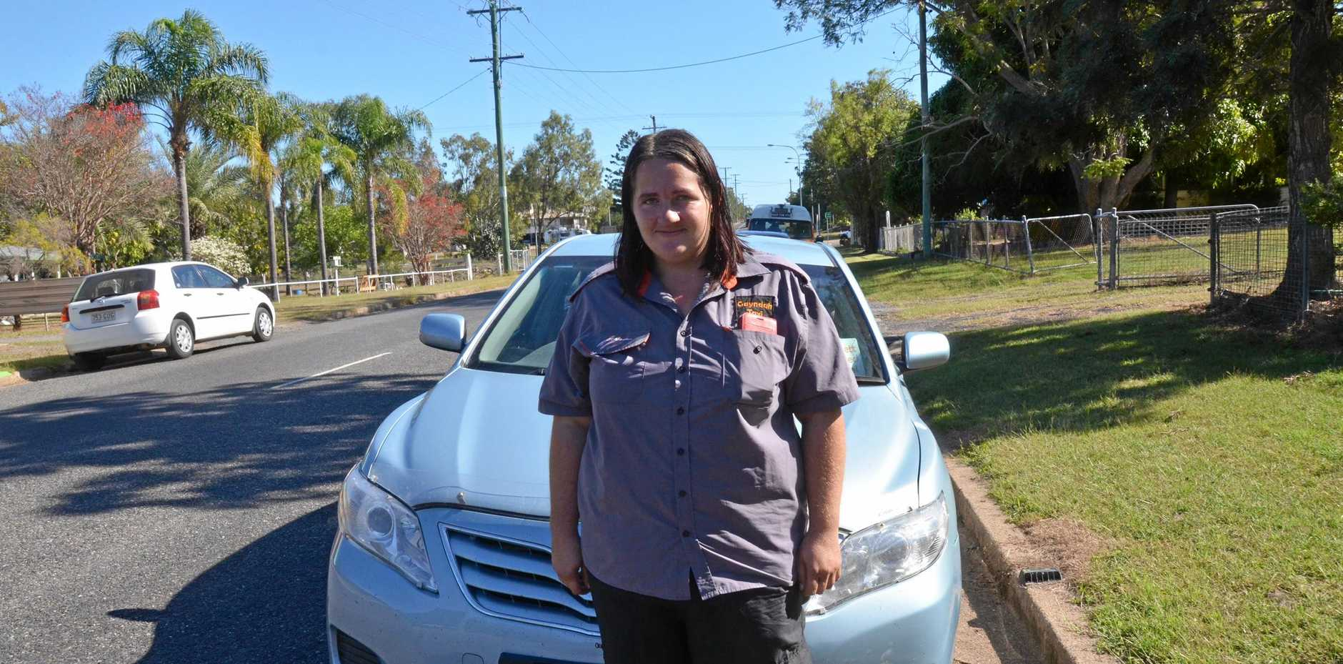RIDE ON: Mundubbera Ride Share driver Sylvia Stevens stands in front of the service's Toyota Camry.
