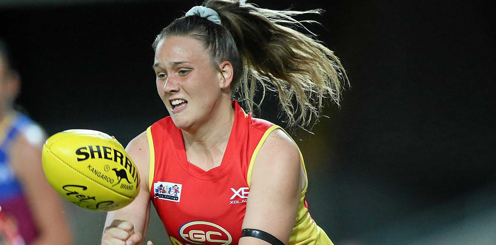 DEBUT: Elle Hampson of the Suns makes a hand pass during the AFL QW Winter Series match between the Gold Coast Suns and the Brisbane Lions at Metricon Stadium on May 25, 2019.