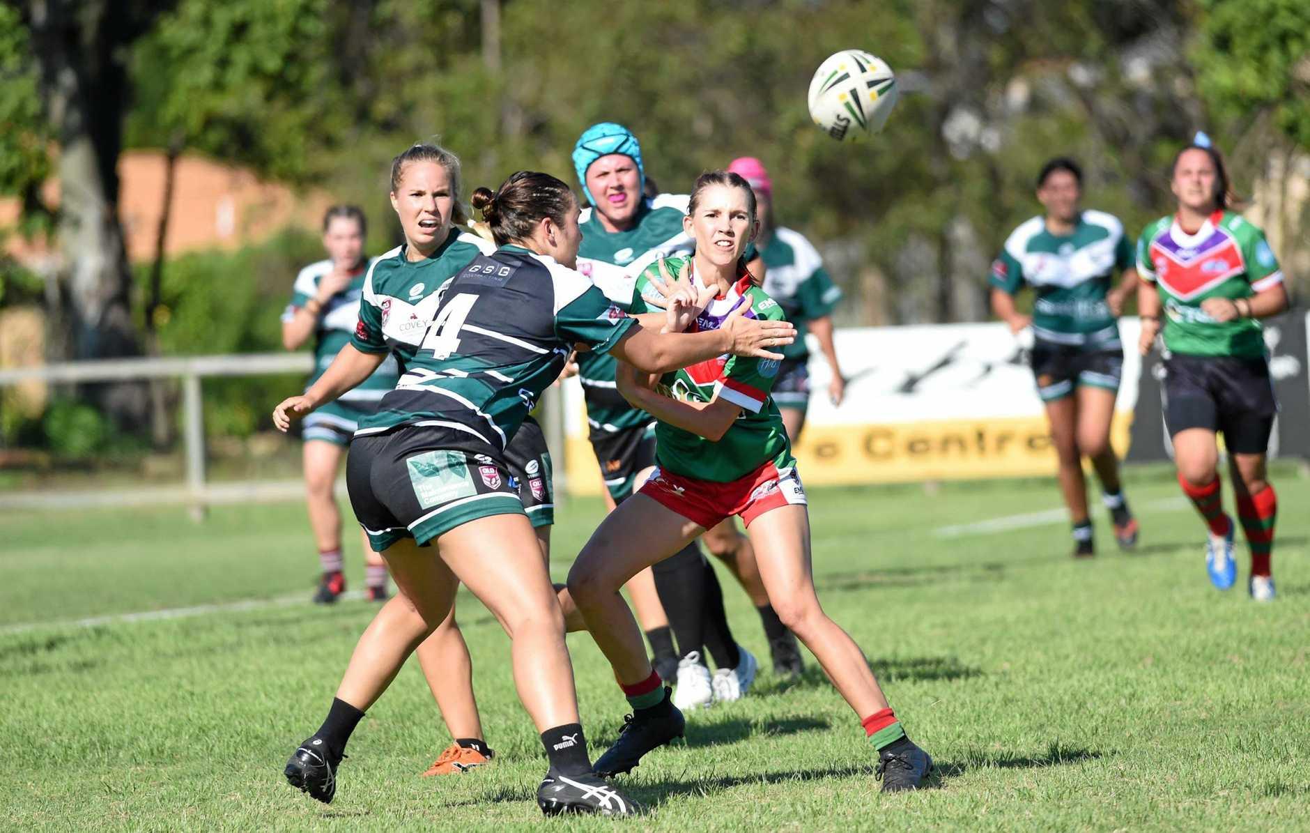 Women's Rugby League Trial - Hervey Bay Seagulls (Light Green) v Maroochydoore Swans (Dark Green) - Skye Houliston (Seagulls) gets a pass away.