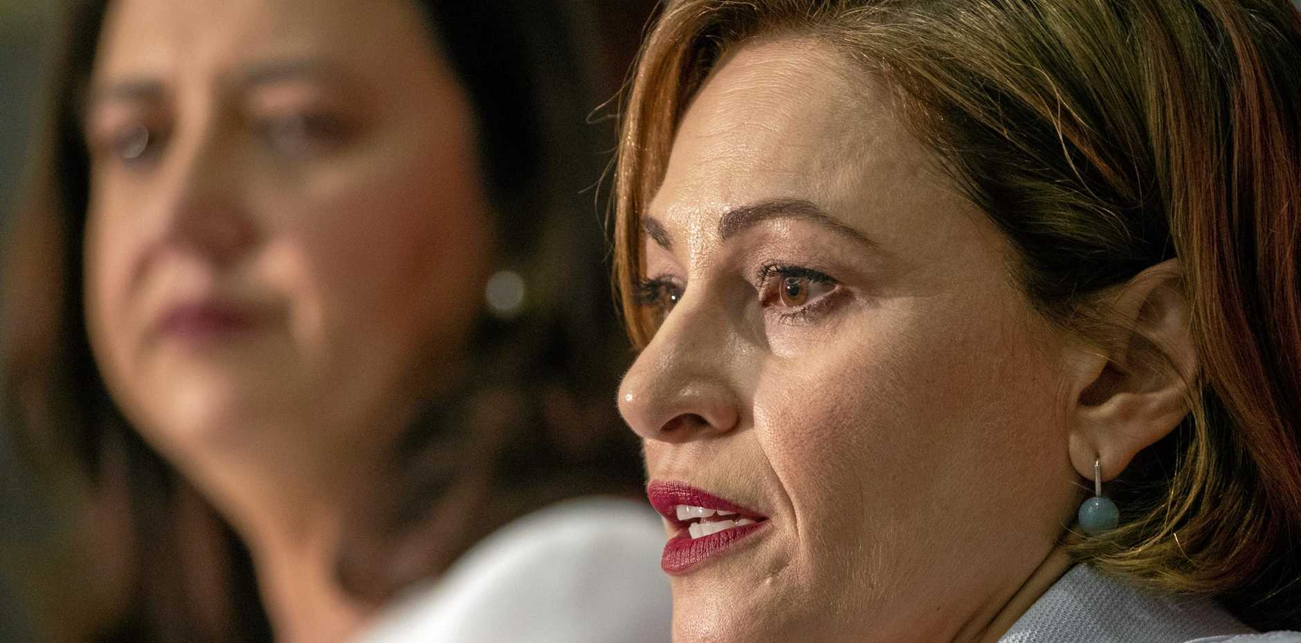 Queensland Premier Annastacia Palaszczuk and Treasurer Jackie Trad (right) speak during the state government's 2019-20 Queensland budget media briefing in Brisbane, Tuesday, June 11, 2019.