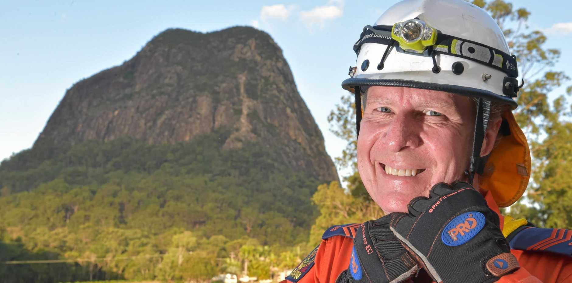 Lou Spann has been rescuing climbers stranded on Glass House Mountains for nearly 30 years.