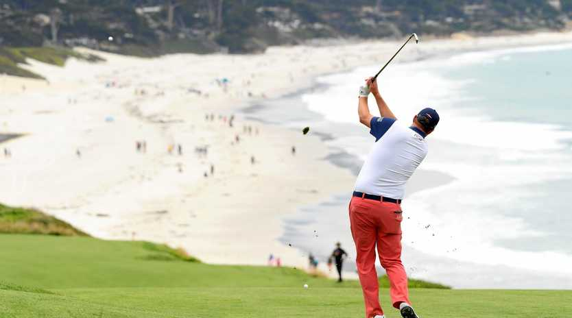 Marc Leishman plays his second shot on the ninth hole during the first round of the US Open at Pebble Beach Golf Links, California. Picture: Harry How/Getty Images