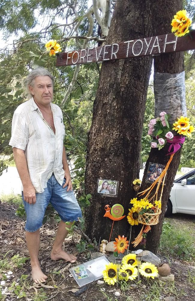 Troy Cordingley returned to Wangetti Beach to lay flowers at the location where he found the body of his daughter Toyah.