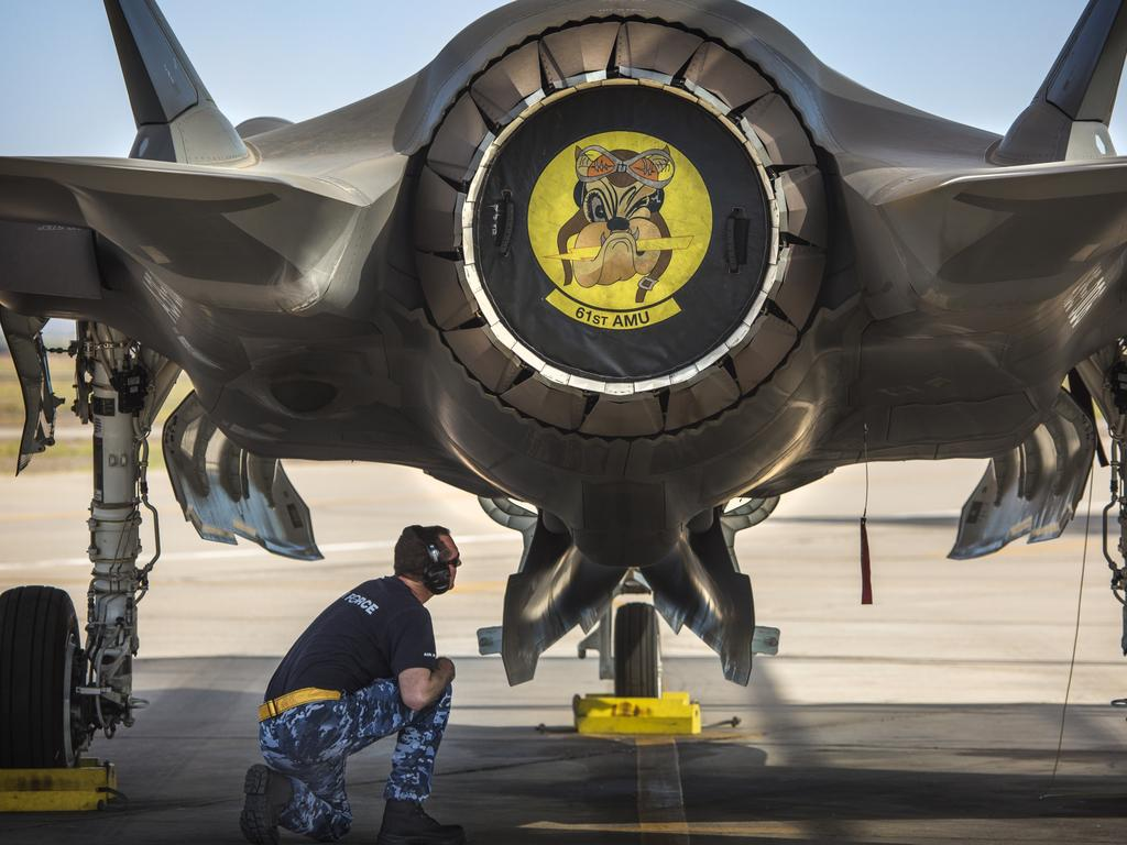 RAAF aircraft maintainer Corporal Cory Cochrane inspects the bomb bay of an Australian F-35A.