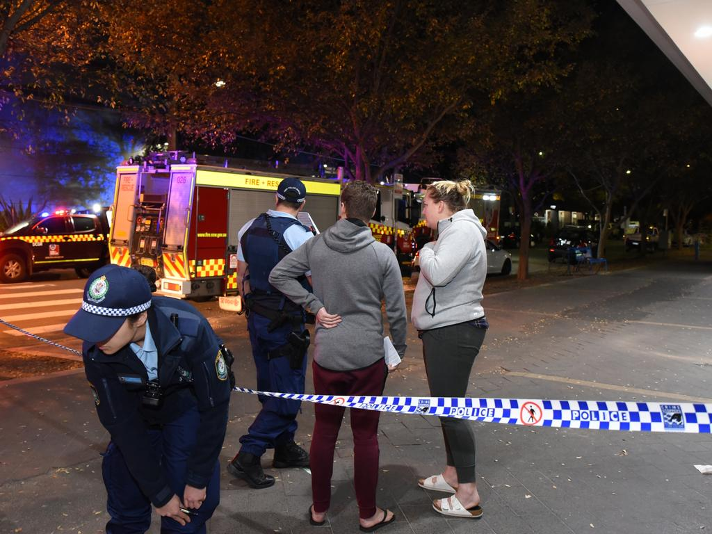 Worried residents evacuated from Mascot Towers in Sydney's inner south speak to police outside the building. Picture: Flavio Brancaleone