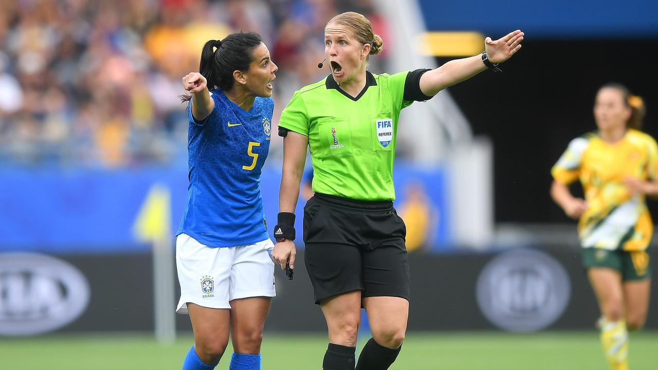 Brazil's Thaisa confronts referee Esther Staubli after Australia's third goal.