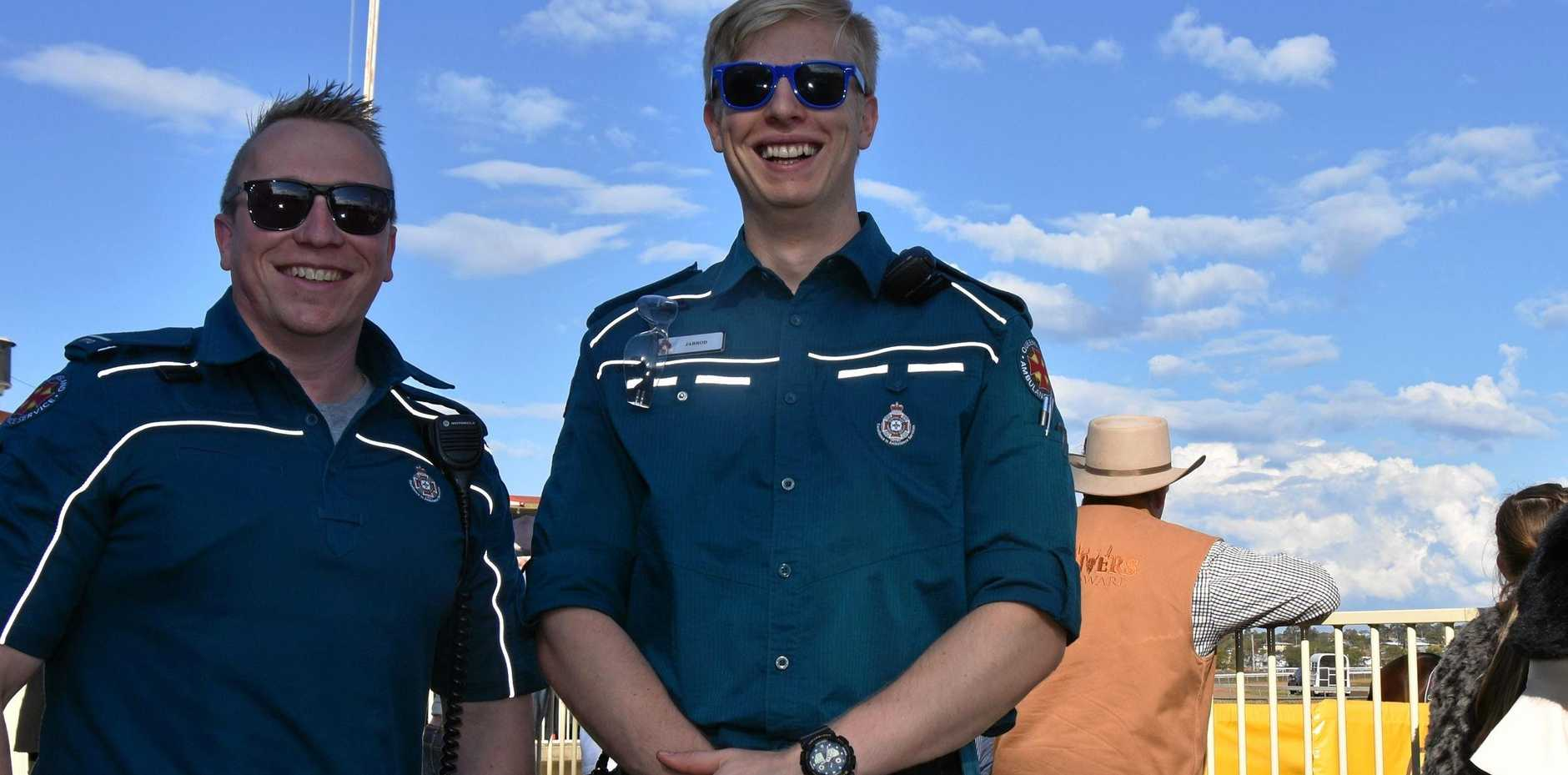 HAPPY TO HELP: Paramedics Marcus Wilson and Jarrod Walker were glad to be able to assist the woman at the Killarney Cup.