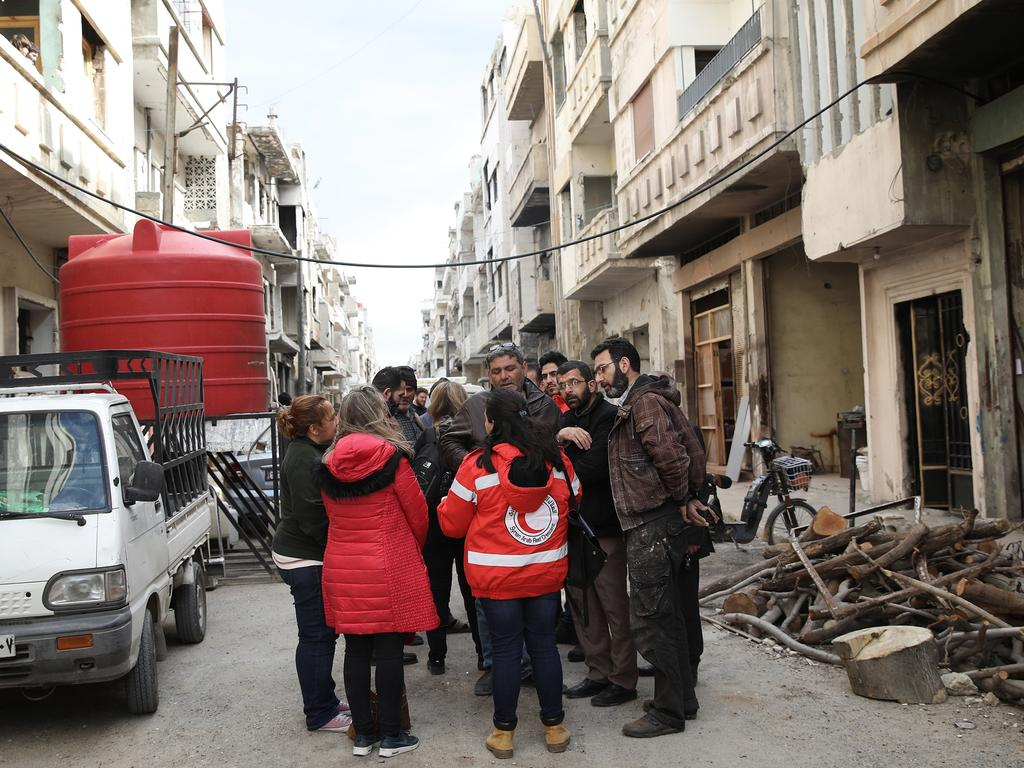 A Red Crescent livelihood team in the street of Al-Khalidiya destroyed district in Homs. Picture: Ella Pellegrini