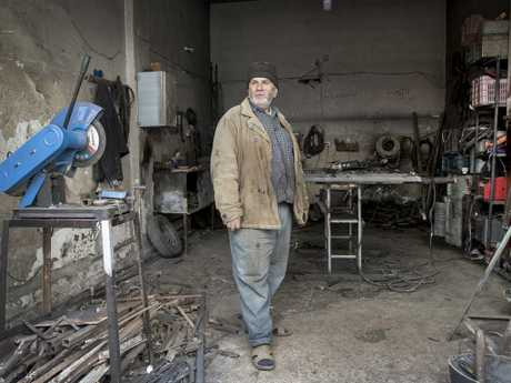 Samir is a blacksmith who was given a donation to re-open his business in the ruins of Al-Khaldia, the Homs Old City, as part of the Syrian Arab Red Crescent livelihoods program. Picture: Ella Pellegrini
