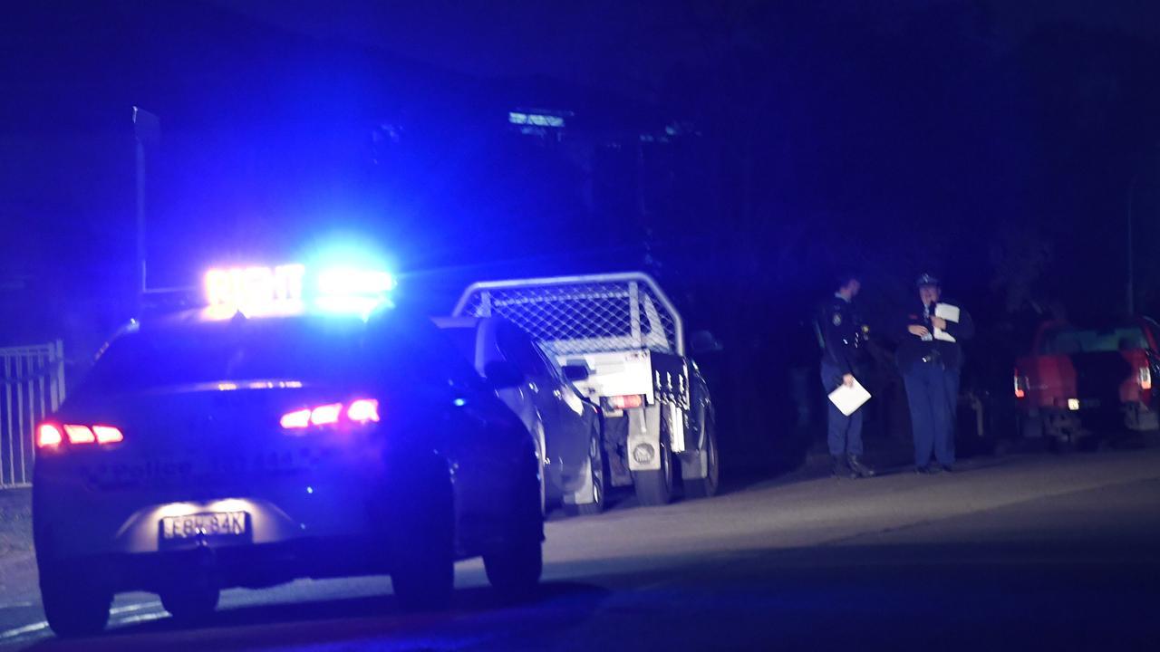 Police in Bungalow Road, Mount Druitt last night. Picture: Gordon McComiskie