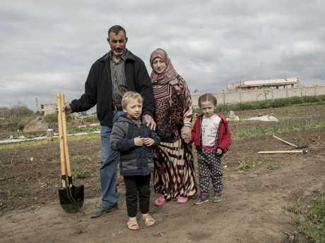 Azaz Hamad Hesien and wife Furat Al-Hesien in Deir ez Zor with twins Osama and Asmaa, 5. Picture: Ella Pellegrini