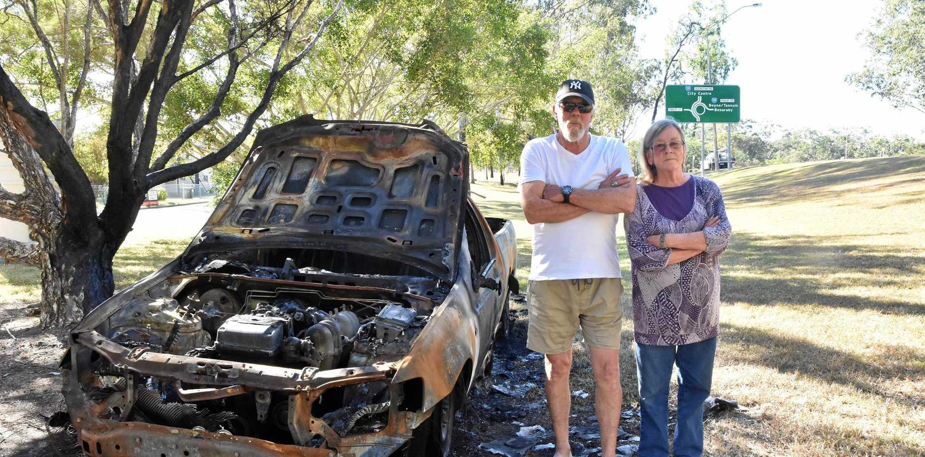 DANGER: Murray, Kaye Cornwell next to the vehicle.