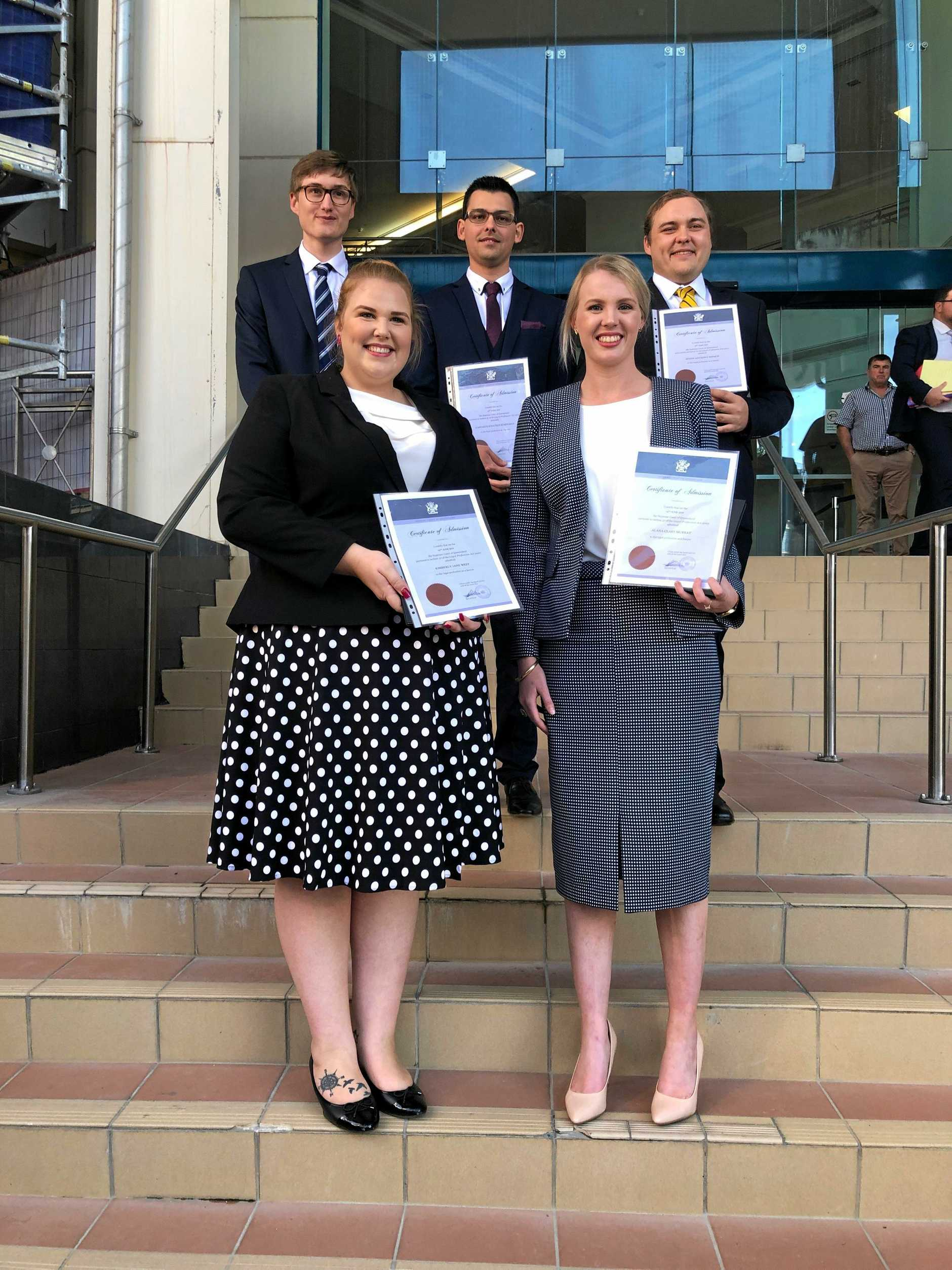 CQUniversity law graduates admitted to the bar on Friday (back) Adam Bressington, Casparus Schoeman, Justin French, Kimberley West and Alana Murray.
