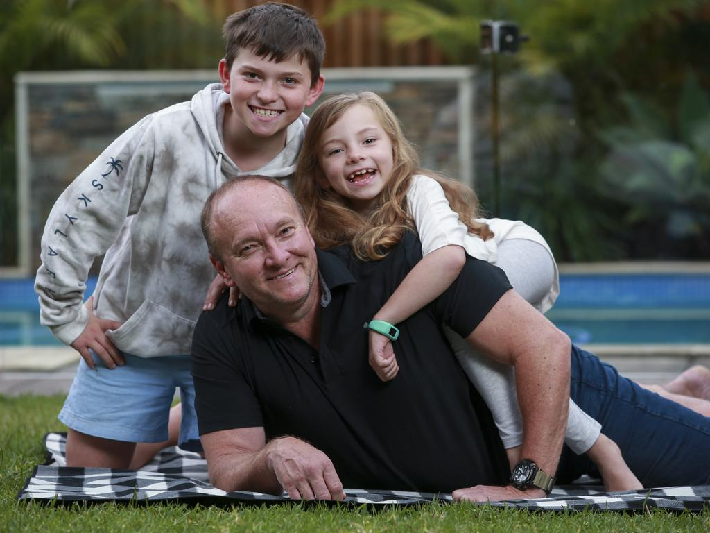 Ian Marr with kids Connor, 10, and Lily, 7, at home in Rouse Hill, today. Picture: Justin Lloyd.