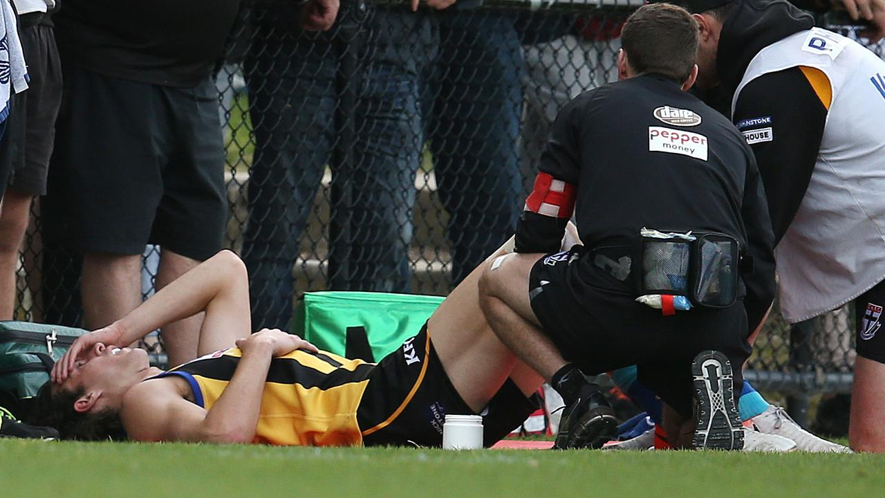 Max King gets his knee assessed. Picture: Michael Klein