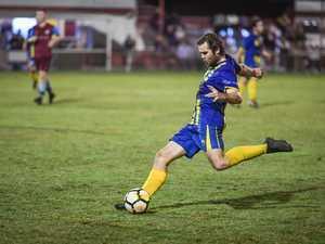 Matt Twyford kicks the ball forwards for the