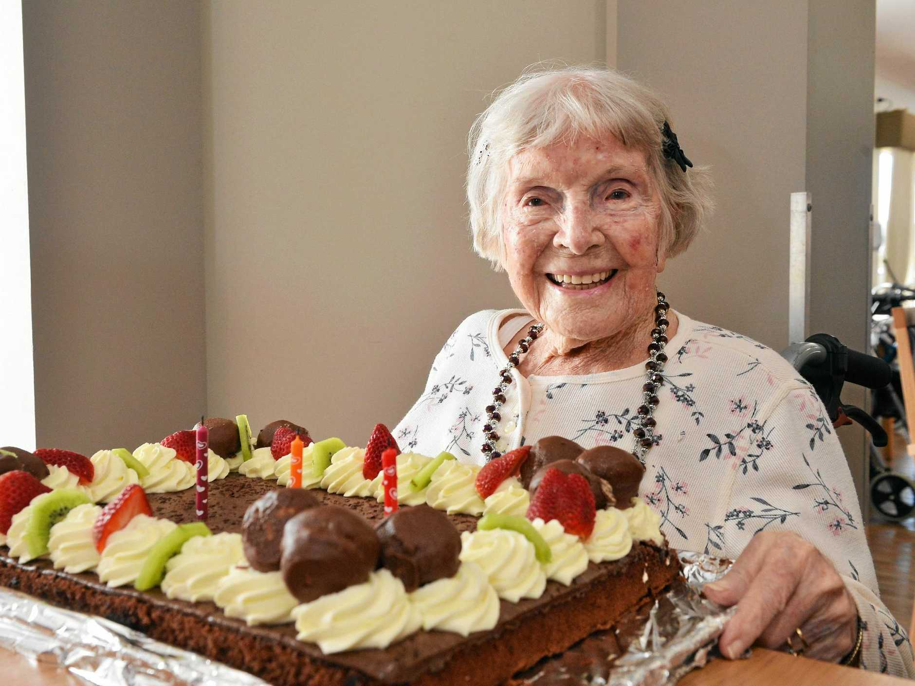 HAPPY BIRTHDAY: Ailsa Ryder enjoyed her cake at a special birthday celebration hosted by Seasons Care Community Golden Beach, where she also celebrated her 100th birthday three years ago.