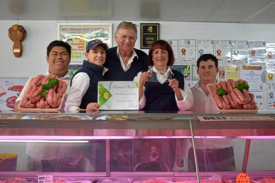 SAUSAGE ROYALTY: Miles Wholesale Meats and Smallgoods staff: school-based Max Andrews, apprentice Jess Eland, owners Daryl and Lyn Bein, and butcher Matt Tong.