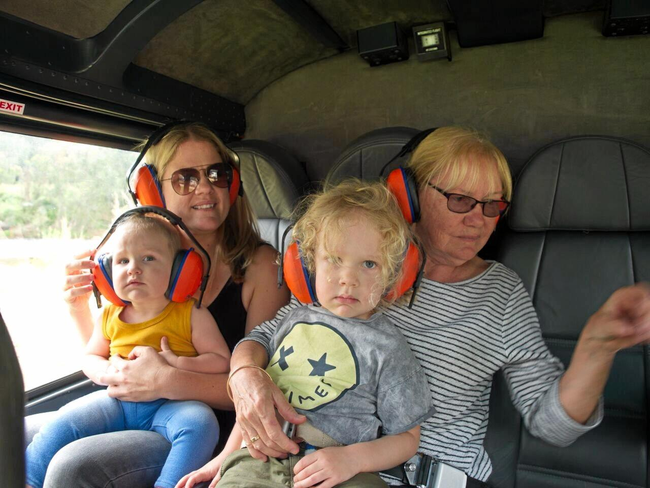 Amanda Ward, Marlie Ward, 1, Harvey Ward, 3, and Fran Balmer on a Whitsunday Helicopter Group flight above the Pioneer Valley Show.