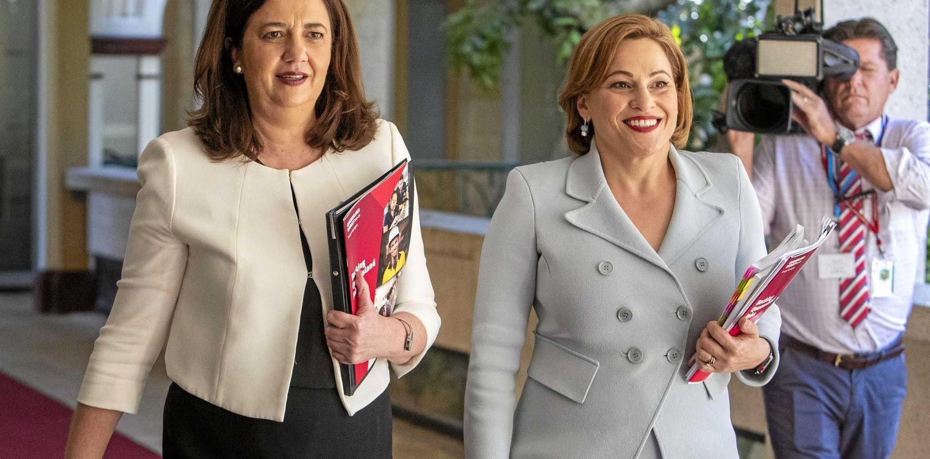 Queensland Premier Annastacia Palaszczuk and Treasurer Jackie Trad (right) walk towards a press briefing to deliver the state government's 2019-20 Queensland budget to journalists at Parliament House in Brisbane, Tuesday, June 11, 2019.(AAP Image/Glenn Hunt) NO ARCHIVING