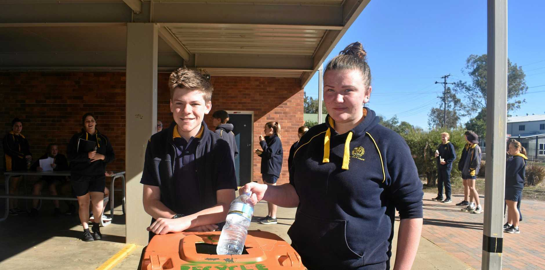 WIN WIN: Environment Committee members, Edward Schefe and Phoebe Cooke helping the environment and raising funds for their school.